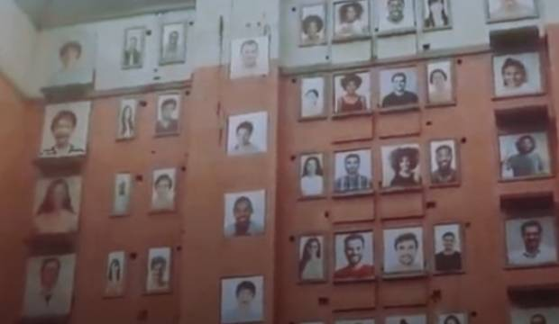 Eerie abandoned building in China with hundreds of smiling portraits