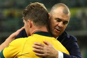 Michael Cheika embraces Wallabies captain Michael Hooper after Australia's Rugby World Cup quarterfinal exit.