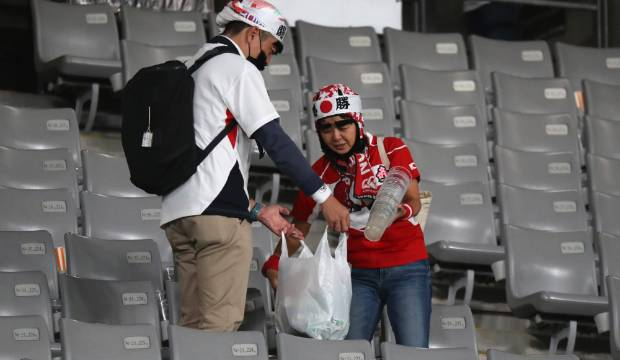 Japan v South Africa: Japanese fans wipe away tears to clean up stadium
