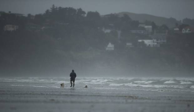 'Strong, potentially damaging winds' for north as snow shuts roads in south