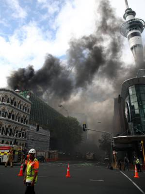 AUCKLAND, NEW ZEALAND - OCTOBER 22: Smoke is seen coming from the SkyCity Convention Centre after a fire broke out on ...