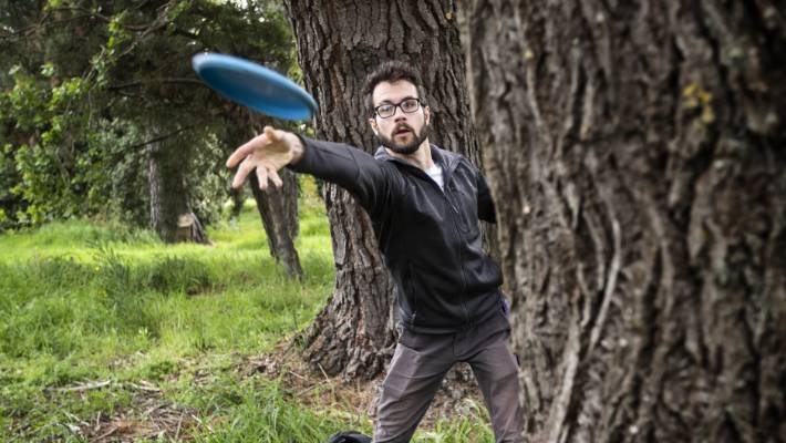 Chris Hopman plays disc golf at Christchurch's newest course, near QEII. The mature trees,  which once featured at the Ascot traditional golf course, are ideal for disc golf.