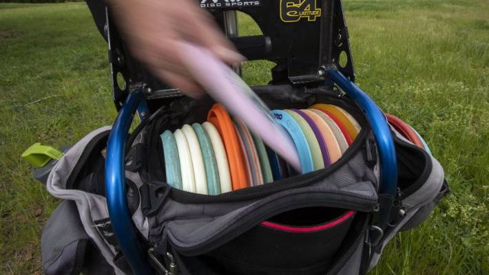 Keen disc golfers carry 20 or more discs. Some are suited for long drives, others for doglegs.