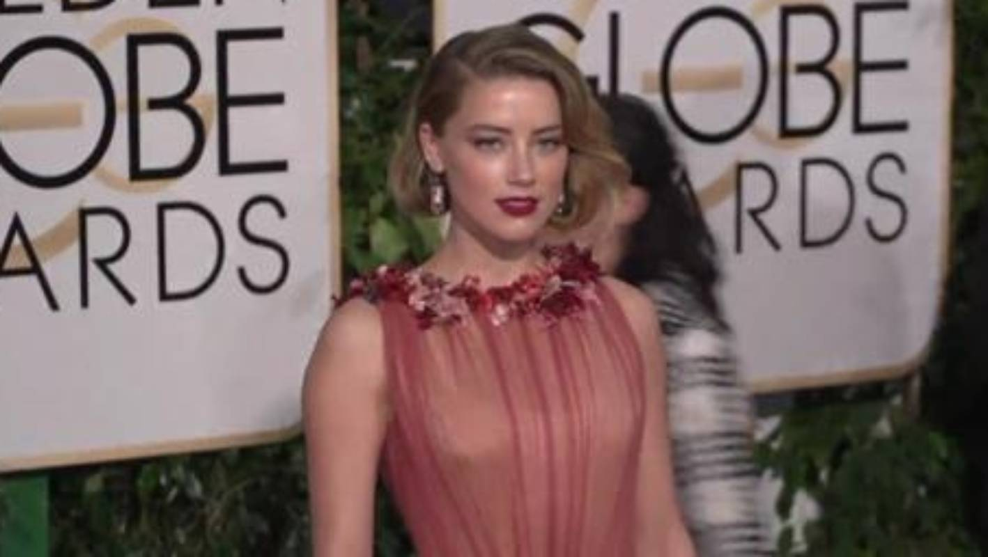 Petition to have 'domestic abuser' Amber Heard removed ...