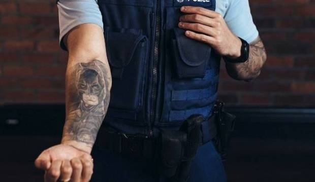 'Cringe worthy' - small town cop against police tattoo campaign
