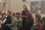 A midwife speaks to the crowd gathered for a meeting about maternity services in the Hutt Valley.