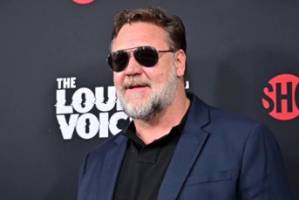 Russell Crowe and his family fled to safety as Australian bush fires engulfed the star's rural property in New South Wales.