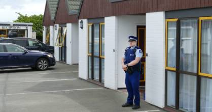 Police on guard outside a motel room in Invercargill on Sunday.