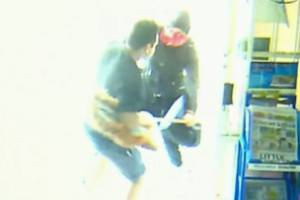 Man with a mop takes on armed robbers.