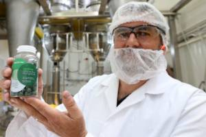 Sanford general manager innovation Andrew Stanley holds up a  bottle of mussel powder pills, at their existing site in ...