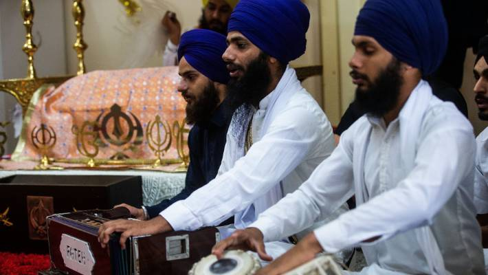 The Palmy Punjabi Festival will feature food, giveaways and entertainment. From left, Gajom Singh, Ratandeep Singh  and Varanjit Singh practise a performance in the Sikh temple on Amesbury St.