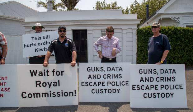 'Disgusting' gun protest outside primary school fires up former PM Helen Clark