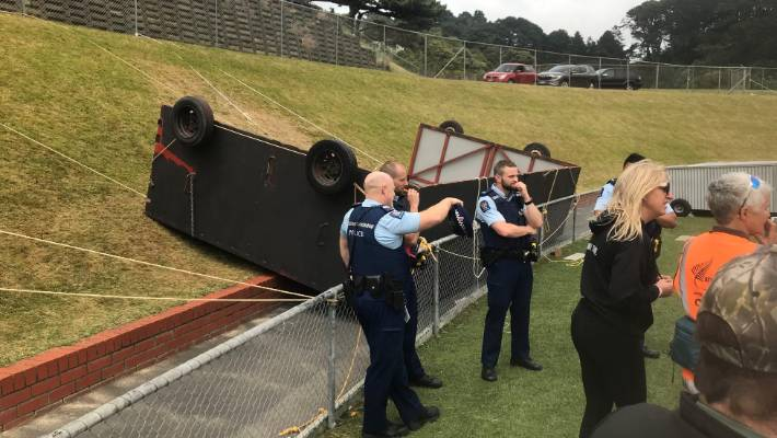 A large metal structure which blew over the fence at Newtown Park and injured two people.