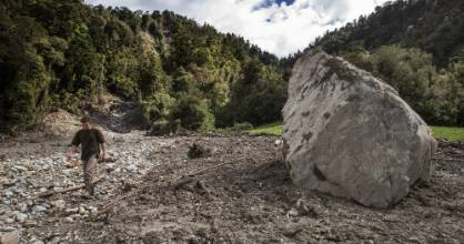 A massive slip came down covering a large paddock, including a huge rock on the dairy farm Samuel Walsh manages near ...