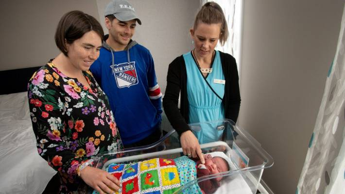 Te Papaioea birthing centre celebrated its second birthday with the birth of its 643rd baby, Maggie Brosnan, pictured with parents Kelsey and James Brosnan and clinical midwife manager Jane Spilman.
