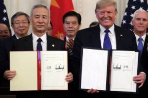 US President Donald Trump, right, signs a trade agreement with Chinese Vice Premier Liu He, China's top trade ...