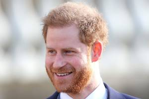 Prince Harry has touched down in the UK looking relaxed as he heads to a working summit for one of his initiatives.