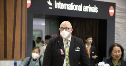 Some travellers wore face masks as they exited the arrivals hall at Auckland International Airport on Sunday.