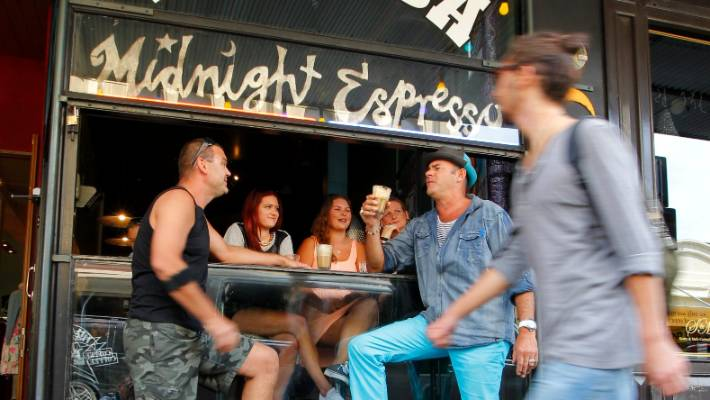Hamish McIntyre, owner of Midnight Espresso (left) recently put up the price of coffee by 50 cents to cover the cost of wage increases. (File photo)