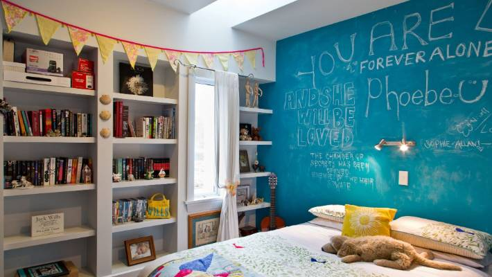 There is a world of possibilities away from traditional colour schemes in children's bedrooms. This chalk wall is one example of how you can mix things up.