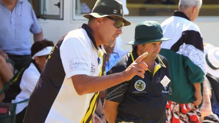 Skips Wayne Te Huki, left, and Darren Goodin take part in the final held at Paritutu Bowling Club on Sunday.