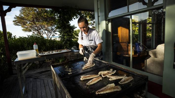 Meadowbank Lodge chef Catherine Taylor caters for crowds of hungry kayakers and trampers passing through Awaroa Bay.