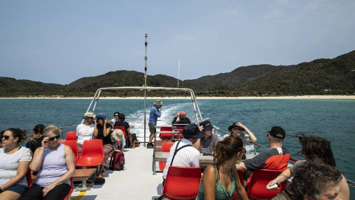 To get to Awaroa Beach, you'll need to take a water taxi, or park at the end of the long inlet.