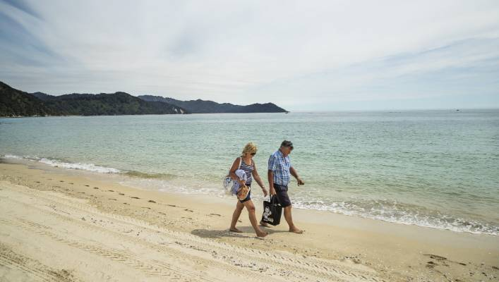"""""""We couldn't be further away from Ireland."""" Irish couple Eugene and Catriona Scally enjoyed the solitude on Awaroa Beach."""