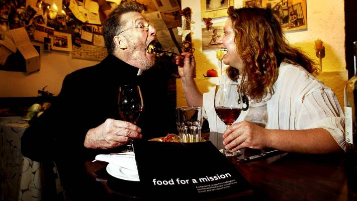 Sir Des Britten, when he was head of Wellington City Mission, with Maria Pia Razza of restaurant Maria Pia's, promoting a charity cookbook.
