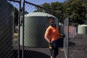 Contractor Richards Price erects fencing around a water filling station in Kaikohe, which now may not be needed thanks ...