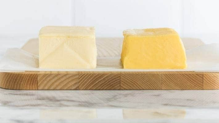 Butter from grain-fed dairy cows sits next that butter from grass-fed dairy cows. Lewis Road Creamery founder Peter Culinane says US consumers are struck by New Zealand butter's golden hue.