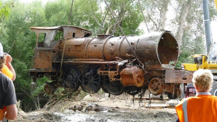 Lumsden Heritage Trust removing the first old 1885 V Class locomotive from the Oreti River in Southland.