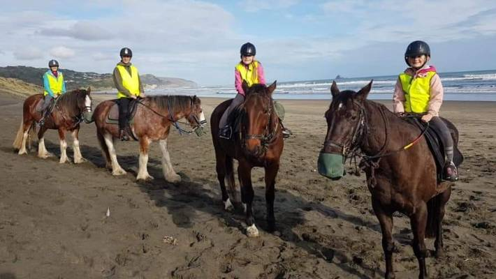 Riding on Muriwai's endless beach.