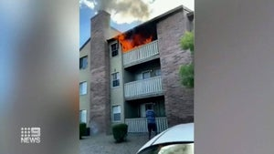 Dying mother throws boy from burning building in US