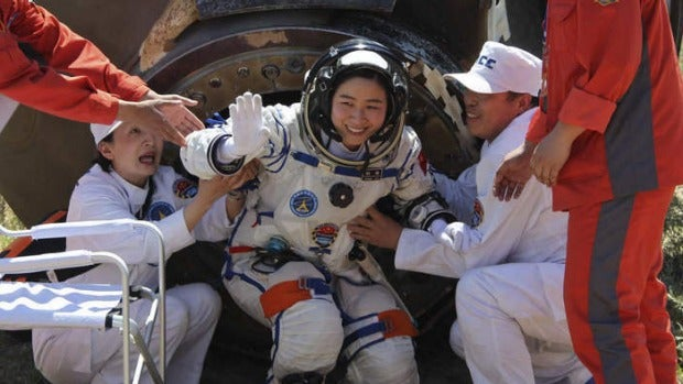 The final frontier: China's first female astronaut Liu Yang leaves the re-entry capsule of a Shenzhou-9 spacecraft in  ...