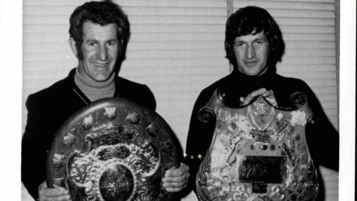 Marlborough captain Ray Sutherland, left, proudly holds the Ranfurly Shield and his brother Alan, the Seddon Shield, in 1973.