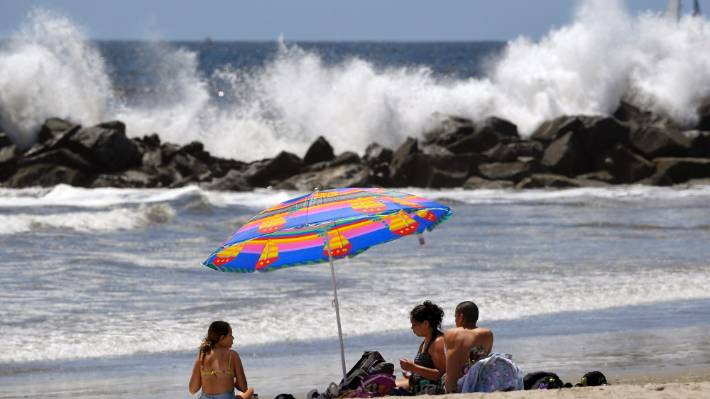 Venice Beach was hit by large waves as authorities reopened some California beaches following the coronavirus lockdown.