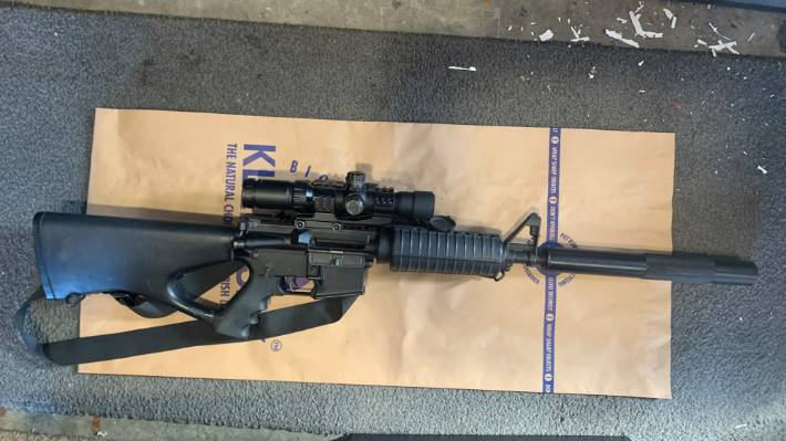 An AR-15 was found at one of the properties raided by police.