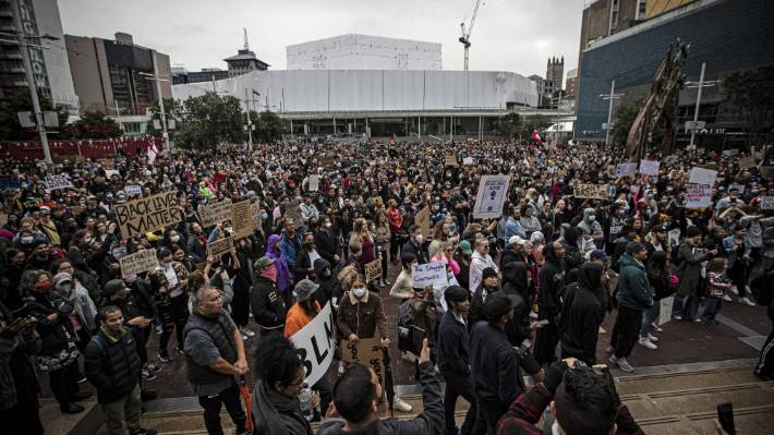 Protesters gather in Auckland's Aotea Square and prepare to walk down Queen St.