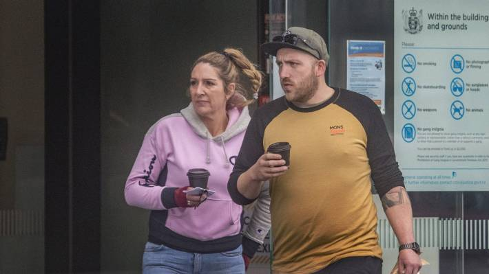 Kane and Joanna McNeill, of Pet and Garden Supplies, leave Christchurch District Court on Tuesday.