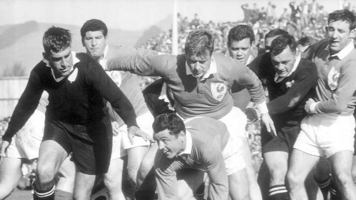 All Blacks hooker Dennis Young (right) watches French halfback Pierre Lacroix be challenged by Colin Meads in a test in 1961.