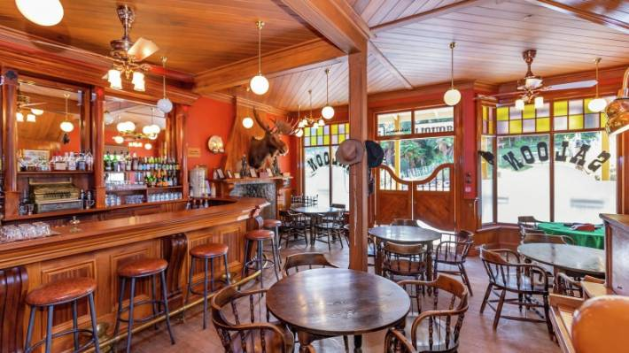 The saloon is about as authentic as they come, from the spitoons, to the moose head.