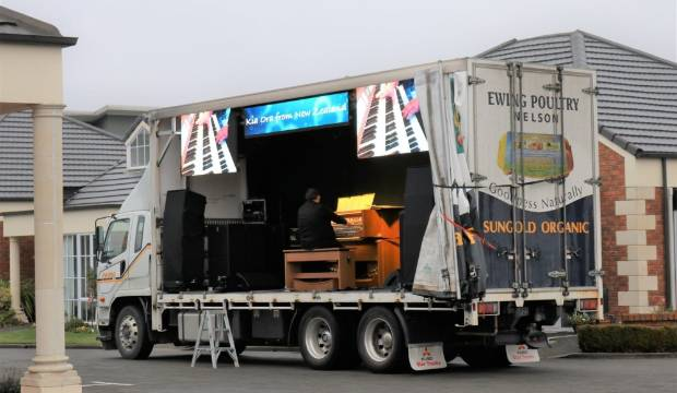 Travelling organ concert lurches to halt after truck hits a tree