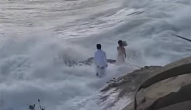 Bride and groom washed out to sea during photo shoot on a US beach
