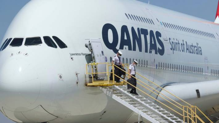 Crew members leave a Qantas Airbus A380 after it arrived at Southern California Logistics Airport in Victorville.