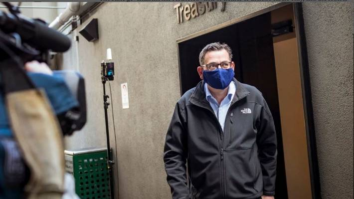 Victorian Premier Daniel Andrews departs a Covid-19 news conference in Australia wearing a mask.