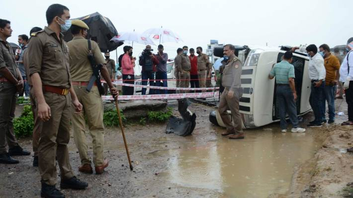 Policemen cordon off the site where Vikas Dubey, a top crime suspect linked to the death of eight policemen was killed near Kanpur, India.