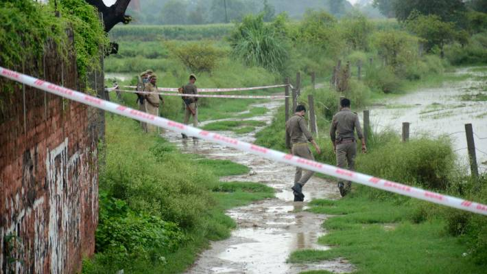 Policemen inspect the site where Vikas Dubey, a top crime suspect linked to the death of eight policemen was killed near Kanpur, India.