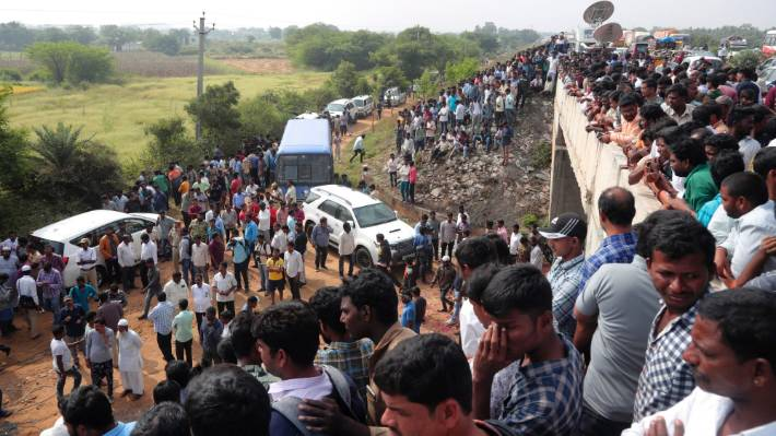 From December last year, people gather near the site where four men suspected of raping and killing a woman were fatally shot by police in Shadnagar near Hyderabad, India.
