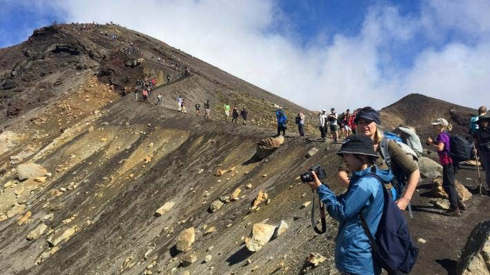 Tourists stream across the busy Tongariro Crossing on Easter Sunday, when queues for toilets stretched to the dozens. (File photo)